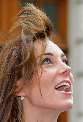 The wind catches the hair of Britain's Catherine, Duchess of Cambridge, as she arrives to attend the Place2Be Headteacher Conference at Bank of America Merrill Lynch in London on November 18, 2015.      / AFP / POOL / Chris Jackson        (Photo credit should read CHRIS JACKSON/AFP via Getty Images)