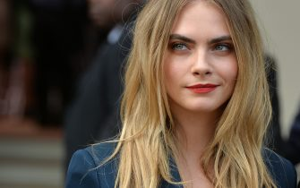 LONDON, ENGLAND - SEPTEMBER 15:  Cara Delevingne attends the Burberry Prorsum show during London Fashion Week Spring Summer 2015 on September 15, 2014 in London, England.  (Photo by Anthony Harvey/Getty Images)