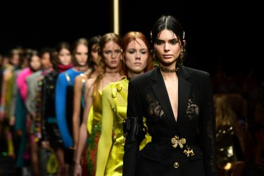 Model Kendall Jenner (R) presents a creation during the Versace women's Fall/Winter 2019/2020 collection fashion show, on February 22, 2019 in Milan. (Photo by Miguel MEDINA / AFP)        (Photo credit should read MIGUEL MEDINA/AFP via Getty Images)