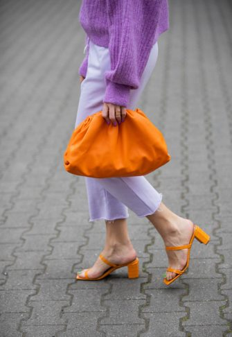 BERLIN, GERMANY - MAY 19: Sonia Lyson is seen wearing orange sandals By Far x Luisa Via Roma LVR, grey jogger pants Lala Berlin, purple knit &Other Stories, orange bag Bottega Veneta on May 19, 2020 in Berlin, Germany. (Photo by Christian Vierig/Getty Images)
