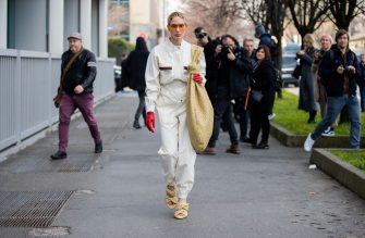 MILAN, ITALY - FEBRUARY 23: Sira Pevida is seen wearing beige oversized Bottega Veneta bag, sandals, Gucci overall, sunglasses, red gloves, Prada hair clip outside Boss during Milan Fashion Week Fall/Winter 2020-2021 on February 23, 2020 in Milan, Italy. (Photo by Christian Vierig/Getty Images)