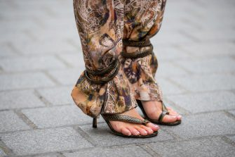 PARIS, FRANCE - FEBRUARY 29: Gitta Banko is seen wearing wide trousers in a decorative paisley design Madeleine, sandals with spiral ankle strap in python-printed calfskin during Paris Fashion Week - Womenswear Fall/Winter 2020/2021 : Day Six on February 29, 2020 in Paris, France. (Photo by Christian Vierig/Getty Images)