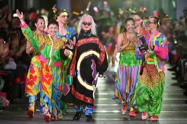 "Models display creations during the fashion event ""super energy !!"" produced by Japanese designer Kansai Yamamoto in Tokyo on June 12, 2015. AFP PHOTO / KAZUHIRO NOGI        (Photo credit should read KAZUHIRO NOGI/AFP via Getty Images)"