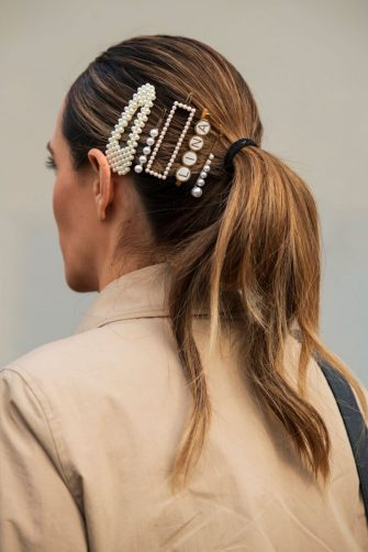 PARIS, FRANCE - MARCH 03: A guest wears pearl hair clips and slides in her pony tail on March 03, 2020 in Paris, France. (Photo by Kirstin Sinclair/Getty Images)