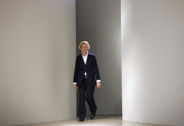 MILAN, ITALY:  German designer Jil Sander appears on the catwalk at the end of her Spring/Summer 2005 women's collection at Milan fashion week, 01 October 2004.  AFP PHOTO/Paolo COCCO  (Photo credit should read PAOLO COCCO/AFP via Getty Images)