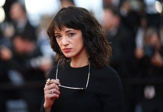 """Italian actress Asia Argento poses as she arrives on May 19, 2018 for the closing ceremony and the screening of the film """"The Man Who Killed Don Quixote"""" at the 71st edition of the Cannes Film Festival in Cannes, southern France. (Photo by Loic VENANCE / AFP)        (Photo credit should read LOIC VENANCE/AFP via Getty Images)"""