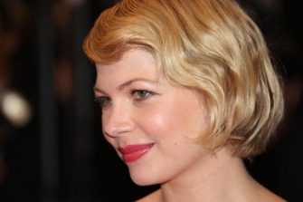 """US actress Michelle Williams poses as she arrives to attend the screening of Canadian director Atom Egoyan's film 'Adoration' at the 61st Cannes International Film Festival on May 22, 2008 in Cannes, southern France. The May 14-25 festival winds up with the awards ceremony for the prestigious Palme d'Or, to be determined by a jury headed by Hollywood """"bad boy"""" Sean Penn.     AFP PHOTO / VALERY HACHE (Photo credit should read VALERY HACHE/AFP via Getty Images)"""