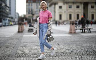BERLIN, GERMANY - MARCH 07: Mandy Bork wearing Saint Laurent shirt, Burberry trench coat, Bulgari bag, Balenciaga Triple S, Nakd jeans, Cartier jewelry and Dior earrings on March 07, 2019 in Berlin, Germany. (Photo by Jeremy Moeller/Getty Images)