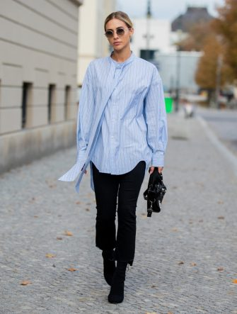 BERLIN, GERMANY - OCTOBER 25: Ann-Kathrin Götze is seen wearing blue striped button shirt Balenciaga, black Balenciaga bag, black cropped denim jeans Mother, Louis Vuitton shoes on October 25, 2019 in Berlin, Germany. (Photo by Christian Vierig/Getty Images)