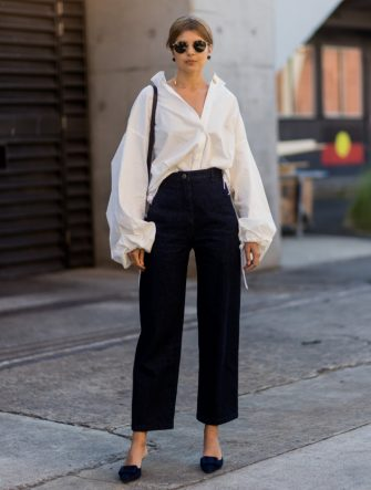 SYDNEY, AUSTRALIA - MAY 17: Talisa Sutton wearing a white button shirt with wide sleeves, navy pants, black bag  at day 4 during Mercedes-Benz Fashion Week Resort 18 Collections at Carriageworks on May 17, 2017 in Sydney, Australia. (Photo by Christian Vierig/Getty Images)