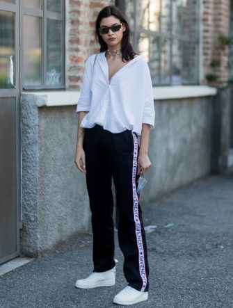 MILAN, ITALY - JUNE 19: A guest wearing a white button shirt and a Givenchy jogger pants is seen outside Malibu 1992 during Milan Men's Fashion Week Spring/Summer 2018 on June 19, 2017 in Milan, Italy. (Photo by Christian Vierig/Getty Images)