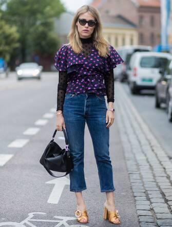 OSLO, NORWAY - AUGUST 24: Annabel Rosendahl wearing a black Loewe bag, purple blouse, denim jeans outside Vanessa Rudjord on August 24, 2017 in Oslo, Norway. (Photo by Christian Vierig/Getty Images)