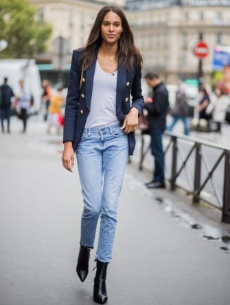 PARIS, FRANCE - SEPTEMBER 28: Model Cindy Bruna wearing denim jeans, ankle boots, blazer, white tshirt is seen outside Balmain during Paris Fashion Week Spring/Summer 2018 on September 28, 2017 in Paris, France. (Photo by Christian Vierig/Getty Images)