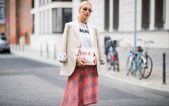 BERLIN, GERMANY - JULY 06: Viktoria Rader wearing red plaid skirt, asymmetrical sneaker, Celine clutch and blazer seen outside William Fan during the Berlin Fashion Week July 2018 on July 6, 2018 in Berlin, Germany. (Photo by Christian Vierig/Getty Images)