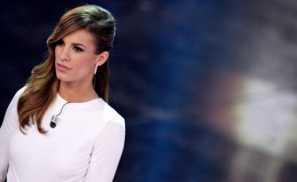 Italian TV personality and model, as well as girlfriend of US actor George Clooney, Elisabetta Canalis, takes the stage at the Ariston Theatre in Sanremo, Italy, during the 61th Sanremo Music Festival on February 16, 2011. AFP PHOTO/TIZIANA FABI (Photo credit should read TIZIANA FABI/AFP via Getty Images)