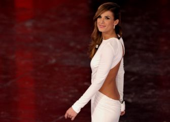 Italian TV personality and model, as well as girlfriend of US actor George Clooney, Elisabetta Canalis, takes the stage at the Ariston Theatre in Sanremo, Italy, during the 61st Sanremo Music Festival on February 16, 2011. AFP PHOTO/TIZIANA FABI (Photo credit should read TIZIANA FABI/AFP via Getty Images)