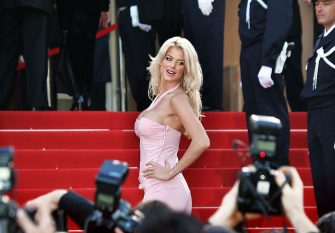 """CANNES, France:  Model Victoria Silvstedt arrives for the official projection of of the Cohen brothers' film """"Ladykillers"""", 18 May 2004, at the 57th Cannes Film Festival in the French Riviera Town. The semi-dark Coen brothers comedy got a warm reception at the Cannes film festival today, tightening the US grip on the event which this year has been glowing bright with star wattage. AFP PHOTO/FRANCOIS GUILLOT  (Photo credit should read FRANCOIS GUILLOT/AFP via Getty Images)"""