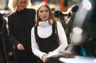 NEW YORK, NEW YORK - FEBRUARY 08: Lila Moss, daughter of Kate Moss, wears a white wool knitted turtleneck pullover, black overalls, outside Longchamp, during New York Fashion Week Fall-Winter 2020, on February 08, 2020 in New York City. (Photo by Edward Berthelot/Getty Images)