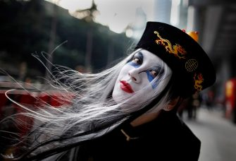 A girl dressed for Halloween attends a charity parade in Hong Kong on October 30, 2010. Hundreds of Hongkongers dressed in wild and wacky Halloween gear turned out to march in the annual parade to raise money for cancer charities in the southern Chinese territory.  AFP PHOTO / DANIEL SORABJI (Photo credit should read DANIEL SORABJI/AFP via Getty Images)