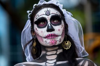 MEXICO CITY, MEXICO - OCTOBER 23: Portrait of a participant who wears a skeleton makeup and parades through the streets during the 'Catrinas Parade', a joyful annual event celebrated at the Day of the Dead (Dia de Muertos) on October 23, 2016 in Mexico City, Mexico. (Photo by Vincent Isore/IP3/Getty Images)