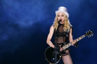 """ROME - SEPTEMBER 06: Madonna performs at during her """"Sticky and Sweet"""" world tour at Olympic Stadium on September 6, 2008 in Rome, Italy. (Photo by Elisabetta Villa/Getty Images)"""