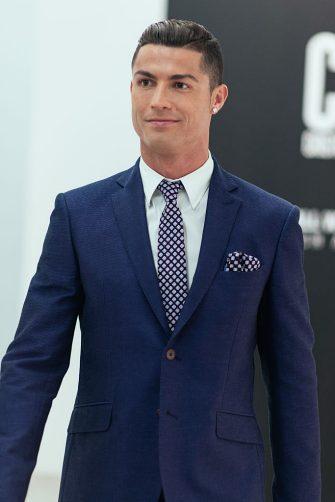 GUIMARAES, PORTUGAL - OCTOBER 5:  Cristiano Ronaldo makes his catwalk debut to model new styles at the global launch of his FW15 CR7 Footwear collection on October 5, 2015 in Guimaraes, Portugal. (Photo by CR7 Footwear via Getty images)