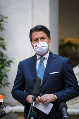 ROME, ITALY - OCTOBER 13: Italian Prime Minister Giuseppe Conte wearing a protective mask holds a press conference on the new safety measures to contain the Covid-19 pandemic, at Palazzo Chigi on October 13, 2020 in Rome, Italy. (Photo by Antonio Masiello#POOL/Alberto Lingria / POOL via Getty Images)