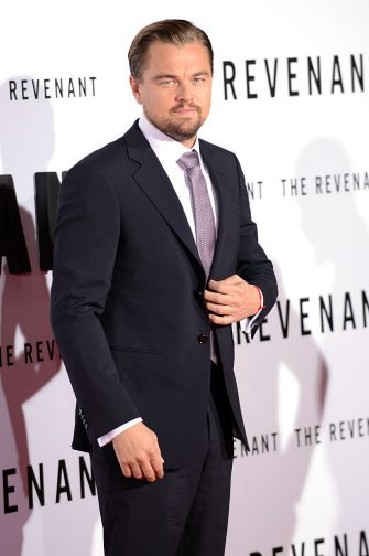 """HOLLYWOOD, CA - DECEMBER 16:  Actor Leonardo DiCaprio arrives for the premiere of 20th Century Fox And Regency Enterprises' """"The Revenant""""  held at TCL Chinese Theatre on December 16, 2015 in Hollywood, California.  (Photo by Albert L. Ortega/Getty Images)"""