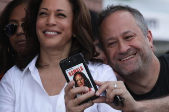 DES MOINES, IOWA - AUGUST 10: Douglas Emhoff, husband of Democratic presidential candidate U.S. Sen. Kamala Harris (D-CA), takes a selfie prior to her delivering a campaign speech at the Des Moines Register Political Soapbox at the Iowa State Fair on August 10, 2019 in Des Moines, Iowa. 22 of the 23 politicians seeking the Democratic Party presidential nomination will be visiting the fair this week, six months ahead of the all-important Iowa caucuses. (Photo by Alex Wong/Getty Images)