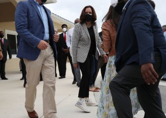 MIAMI GARDENS, FLORIDA - OCTOBER 31: Democratic Vice Presidential Nominee Sen. Kamala Harris (D-CA) shows off her shoes after a person inquired about them during a stop at Buccaneer Park on October 31, 2020 in Miami Gardens, Florida. Harris continues to campaign before the November 3rd election day. (Photo by Joe Raedle/Getty Images)