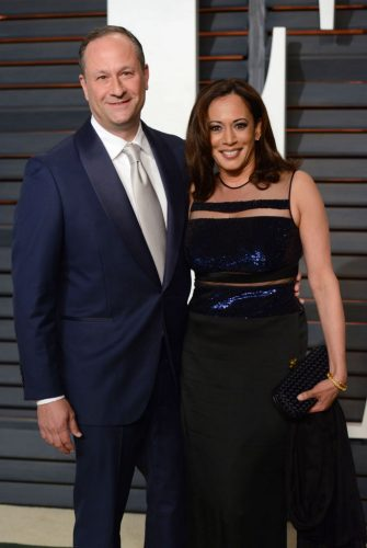 Kamala Harris (R) and her husband Douglas Emhoff attend the 2015 Vanity Fair Oscar viewing party at the Wallis Annenberg Center for the Performing Arts in Beverly Hills on February 22, 2015. (Photo by Chris DELMAS / AFP) (Photo by CHRIS DELMAS/AFP via Getty Images)