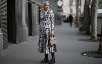 PARIS, FRANCE - JANUARY 20: Nina Suess wearing a Dior look, Hermes bag and Prada boots before Ralph & Russo on January 20, 2020 in Paris, France. (Photo by Jeremy Moeller/Getty Images )