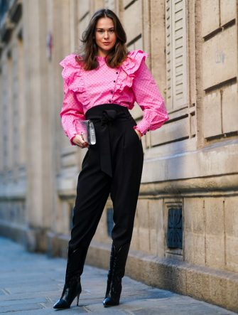 PARIS, FRANCE - NOVEMBER 28: Therese Hellström wears a full Custommade look made of a neon pink ruffled oversized top with puff sleeves and printed polka dots, black pants, black pointy high heeled shoes made of leather with printed crocodile patterns, a silver shiny crocodile pattern Jimmy Choo bag, on November 28, 2020 in Paris, France. (Photo by Edward Berthelot/Getty Images)