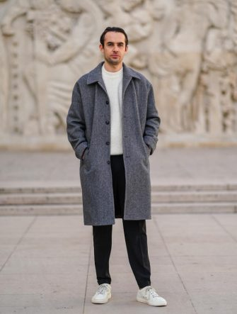 PARIS, FRANCE - NOVEMBER 14: Jordan Lefebvre wears a white American Vintage wool pullover, a gray long wool large coat from American Vintage, black pants, white sneakers from Asphalte, on November 14, 2020 in Paris, France. (Photo by Edward Berthelot/Getty Images)
