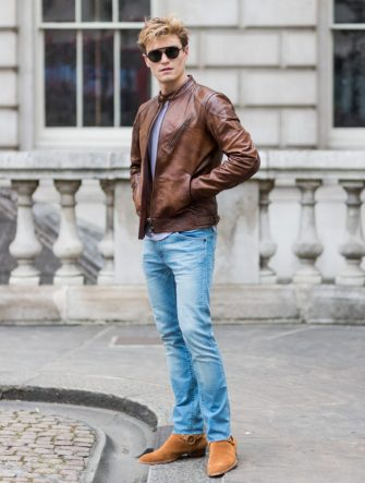 LONDON, ENGLAND - JUNE 12: Oliver Cheshire wearing a brown leather jacket, brown chelsea boots, denim jeans during the London Fashion Week Men's June 2017 collections on June 12, 2017 in London, England. (Photo by Christian Vierig/Getty Images)