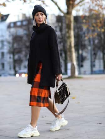 HAMBURG, GERMANY - NOVEMBER 26: Aylin Koenig wearing Balenciaga Triple S, Acne Studios hat, Zara skirt, H&M sweater, Max Mara coat and Fendi bag on November 26, 2018 in Hamburg, Germany. (Photo by Jeremy Moeller/Getty Images)