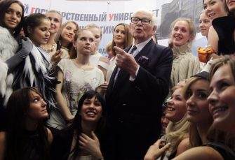 epa02770027 French designer Pierre Cardin is seen with students of Design and Technology Moscow State University in Moscow, Russia, 07 June 2011. Later that same day Cardin will present his new collection at the Kremlin.  EPA/MAXIM SHIPENKOV