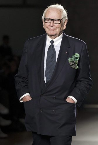 epa03083221 French designer Pierre Cardin takes to the catwalk after the presentation of his collection on the last day of the 9th '080 Barcelona Fashion' Week, in Barcelona, Spain, 28 January 2012.  EPA/ALEJANDRO GARCIA