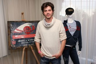 WEST HOLLYWOOD, CA - FEBRUARY 23:  Actor François Arnaud poses with Big Chief at Kari Feinstein's Oscars Style Lounge at Mondrian Los Angeles on February 23, 2012 in West Hollywood, California.  (Photo by Jesse Grant/WireImage)