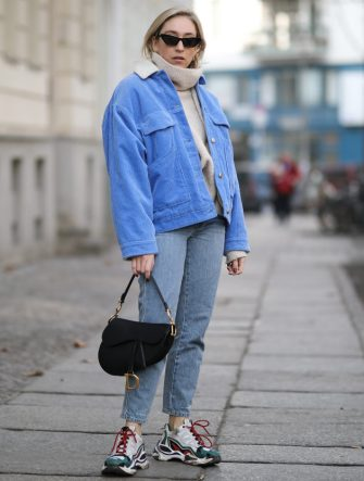 BERLIN, GERMANY - FEBRUARY 28: Sonia Lyson wearing Sandro shoes, Closed jeans, H&M sweater, Samsoe Samsoe jacket, Chimy eyewear, Dior bag on February 28, 2019 in Berlin, Germany. (Photo by Jeremy Moeller/Getty Images)