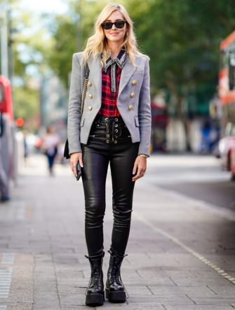 Chiara Ferragni wears sunglasses, a gray blazer jacket, a red tartan checked shirt, black leather pants, earrings, during London Fashion Week September 2018 on September 15, 2018 in London, England. (Photo by Edward Berthelot/Getty Images)