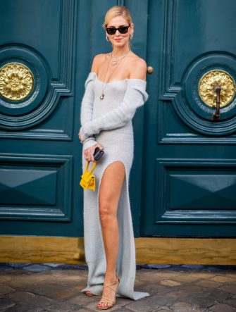 PARIS, FRANCE - SEPTEMBER 24: Chiara Ferragni wearing blue off shoulder dress with slit, yellow bag is seen outside Jacquemus during Paris Fashion Week Womenswear Spring/Summer 2019 on September 24, 2018 in Paris, France. (Photo by Christian Vierig/Getty Images)
