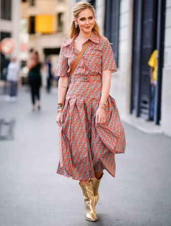 PARIS, FRANCE - JULY 04:  Chiara Ferragni wears a flower print colored dress, golden boots, outside Fendi, during Paris Fashion Week Haute Couture Fall Winter 2018/2019, on July 4, 2018 in Paris, France.  (Photo by Edward Berthelot/Getty Images)