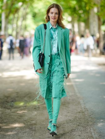 PARIS, FRANCE - JUNE 21: Natalia Vodianova wears a green blazer jacket, a green shirt, a skirt with fringes, green pants, shoes, a bag, outside Berluti, during Paris Fashion Week - Menswear Spring/Summer 2020, on June 21, 2019 in Paris, France. (Photo by Edward Berthelot/Getty Images)