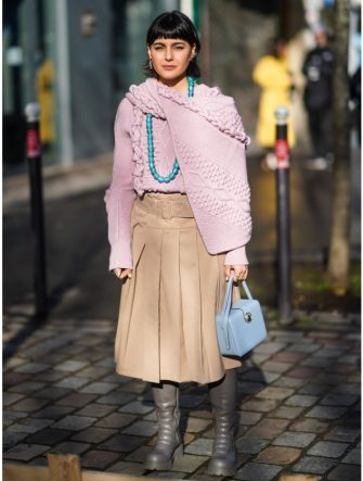 PARIS, FRANCE - FEBRUARY 26: Maria Bernad wears a pale purple/mauve wool pullover with embroidery, a blue bag, a beige pleated skirt, gray leather boots, a long blue necklace, outside Lanvin, during Paris Fashion Week - Womenswear Fall/Winter 2020/2021, on February 26, 2020 in Paris, France. (Photo by Edward Berthelot/Getty Images)