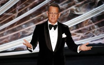 epa08936136 (FILE) - Tom Hanks speaks during the 92nd annual Academy Awards ceremony at the Dolby Theatre in Hollywood, California, USA, 09 February 2020 (reissued 13 January 2021). According to media reports, Tom Hanks will host a TV special during the celebration of the inauguration of Joe Biden as next President of the United States on 20 January 2021.  EPA/ETIENNE LAURENT *** Local Caption *** 55863985