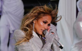 epa08913646 Jennifer Lopez performs in Times Square on New Years Eve in New York City, New York, USA, 31 December 2020.  EPA/GARY HERSHORN POOL