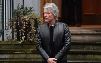 epa08255513 US singer Jon Bon Jovi waits for Britain's Harry, Duke of Sussex (unseen) at Abbey Road Studios in London, Britain, 28 February 2020. The British royal watched the Invictus Choir record the charity song 'Unbroken.' The Duke of Sussex with formally step back from royal duties on 31 March 2020  EPA/NEIL HALL