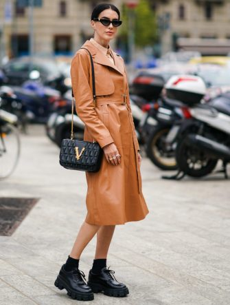 MILAN, ITALY - SEPTEMBER 20:  Brittany Xavier wears sunglasses, a brown leather trench coat, black shoes, a Valentino bag, outside the Sportmax show during Milan Fashion Week Spring/Summer 2020 on September 20, 2019 in Milan, Italy. (Photo by Edward Berthelot/Getty Images)