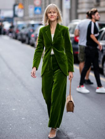 MILAN, ITALY - SEPTEMBER 22: Linda Tol wearing green velvet suit seen outside Salvatore Ferragamo during Milan Fashion Week Spring/Summer 2019 on September 22, 2018 in Milan, Italy. (Photo by Christian Vierig/Getty Images)